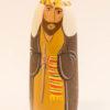 Le santon le caravanier tient une badine pour faire avancer le chameau.